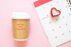 Inspiration quote keep calm and be a great woman on coffee cup with calendar March, 8th. Woman`s Day. Concept stock photos