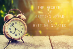Inspiration quote. Inspiration Motivational Life Quote on Vintage Nature and Alarm Clock Background royalty free stock images