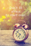Inspiration quote. Inspiration Motivational Life Quote on Vintage Nature and Alarm Clock Background Stock Photography