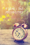 Inspiration quote. Inspiration Motivational Life Quote on Vintage Nature and Alarm Clock Background Stock Image
