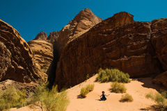 Inspiration retreat concept. Girl relaxing meditation in Wadi Rum desert, Jordan. Travel lifestyle, summer vacations. Photo of the Inspiration retreat concept Royalty Free Stock Images