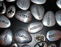 Inspiration Stones. A group of stones and symbols with inspirational messages royalty free stock images