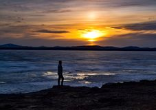 Inspiration. Sunset on a frozen lake Stock Photography