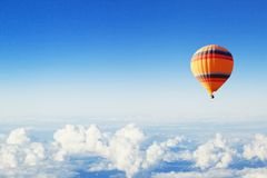 Inspiration or travel background, fly, colorful hot air balloon in blue sky. Inspiration or travel background, fly above the clouds, colorful hot air balloon in royalty free stock image