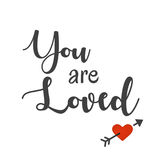 Inspirational and Affirmational Love Quote: You are Loved. In typography with red heart and arrow stock illustration