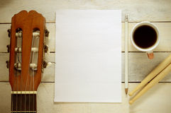 Inspirational background with a Spanish classical guitar on a wooden table Royalty Free Stock Images