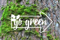 Inspirational banner Go Green banner decorated hand drawn leave, index on the green moss tree bark background stock photography