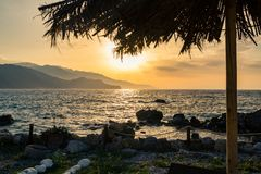 Inspirational beautiful sunrise landscape at sea and mountains Royalty Free Stock Images