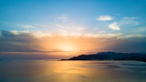 Inspirational beautiful sunset landscape at sea and mountains. Inspirational beautiful mountains landscape with sea, coast, beach and rocks, mountains in royalty free stock image