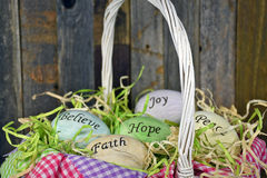 Inspirational Easter eggs in wicker basket Stock Image