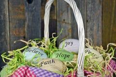 Inspirational Easter eggs in wicker basket Stock Image
