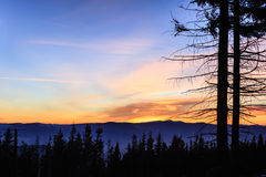 Inspirational landscape sunset in mountains. Beautiful inspirational landscape sunset in mountains. Winter hiking trail at night with colorful sunset sky royalty free stock photo