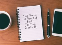 Inspirational Life Quotes. Life Inspirational And Motivational Quotes - Your Dream Job Does Not Exist. You Must Create It. Notepad With Coffee, Pen and Smart stock image