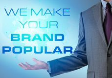 Inspirational motivating company quote with business man. We make your brand popular royalty free stock image