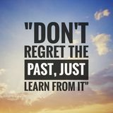 Inspirational motivating quotes on nature background. Don't regret the past, just learn from it royalty free stock image