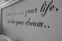 Inspirational motivating quotes on wall, text don`t dream your life but life your dream royalty free stock images