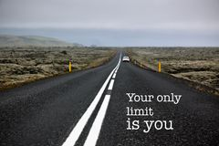 Inspirational motivation quote endless road. Inspirational motivation quote with phrase The only limit is you, endless road adventure background royalty free stock photo