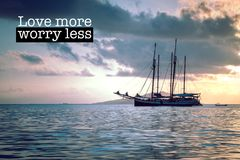 Love more worry less. Inspirational motivation quote with phrase Love more worry less, Beautiful blue seascape yacht background Royalty Free Stock Image