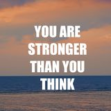 Inspirational motivation quote YOU ARE STRONGER THAN YOU THINK on nature sunset background.  Royalty Free Stock Images