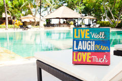 Inspirational Motivational Life Quote wooden board Live Well Laugh Often Love Much on summer Stock Photo