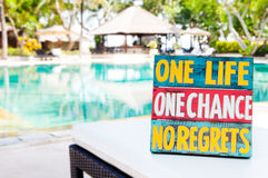 Inspirational Motivational Life Quote wooden board One Life One Chance No regrets on summer Royalty Free Stock Photo