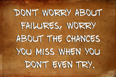 Inspirational motivational quote. – Don't worry about failures, worry about the chances you miss when you don't even try – quote on blurred vintage Royalty Free Stock Image