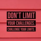 Inspirational motivational quote `Don`t limit your challenges. Challenge your limits.` Stock Image