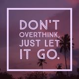 Inspirational Motivational quote `Don`t overthink just let it go`. On coconut trees and sky background royalty free stock image