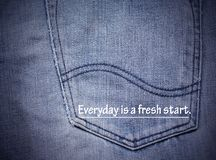 Inspirational quote. Inspirational Motivational quote `Everyday is a fresh start` on blurred back pocket Jeans background Royalty Free Stock Images
