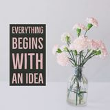 Inspirational motivational quote `Everything begins with an idea.`. With carnation flowers vase background stock images