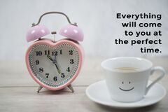 Free Inspirational Motivational Quote - Everything Will Come To You At The Perfect Time. With Alarm Clock And A Smile On Cup Of Coffee. Stock Photo - 214685880