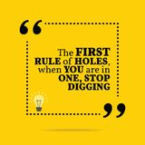 Inspirational motivational quote. The first rule of holes, when. You are in one, stop digging. Simple trendy design Royalty Free Stock Photography