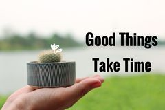Inspirational Quote about patience. Inspirational Motivational Quote `Good Things Take Time` with cactus and river background Royalty Free Stock Images