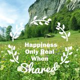 Inspirational quote. Inspirational motivational quote `Happiness Only Real when shared` on blurred flower field background Royalty Free Stock Image