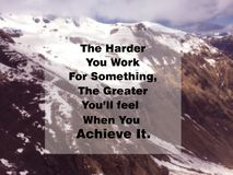 Inspirational quote. Inspirational Motivational quote `The harder you work for something` on blurred snow mountain background Stock Photo