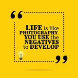 Inspirational motivational quote. Life is like photography. You. Use the negatives to develop. Simple trendy design Stock Photography