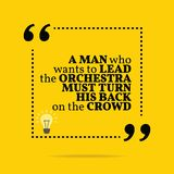Inspirational motivational quote. A man who wants to lead the or. Chestra must turn his back on the crowd. Simple trendy design Stock Image