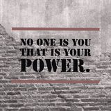Inspirational motivational quote `No one is you that is your power`. On old brick wall background royalty free stock photos