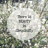 Inspirational quote. Inspirational Motivational quote `there is beauty in simplicity` on blurred flowers background Royalty Free Stock Photo