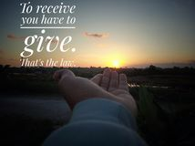 Inspirational motivational quote- to receive you have to give. That is the low. With sunset sunrise background, and a young woman royalty free stock photo