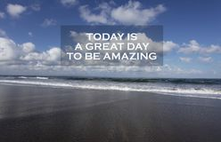 Inspirational motivational quote- Today is a great day to be amazing. With beautiful blue sky, white clouds and black sandy beach royalty free stock photo