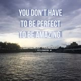 Inspirational Motivational quote `You don`t have to be perfect to be amazing`. On river and bridge background stock images