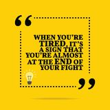 Inspirational motivational quote. When you`re tired, it`s a sign. That you`re almost at the end of your fight. Simple trendy design Royalty Free Stock Photos