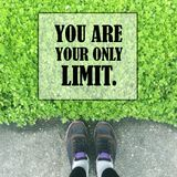 Inspirational quote about limit. Inspirational Motivational quote `you are your only limit` on blurred background Stock Photos