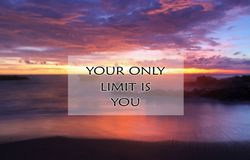 Inspirational motivational quote- Your only limit is you, With beautiful blurry beach landscape scenery in long exposure at sunset royalty free stock image