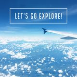 Inspirational motivational travel quote `Let`s go explore`. On sky and airplane wings background royalty free stock photo