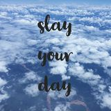 Inspirational motivational travel quote slay your day. Inspirational motivational travel quote `slay your day` on sky background Royalty Free Stock Photos