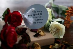 Inspirational motivational words - The way you speak to yourself matters the most. Note to self concept on paper label with roses.