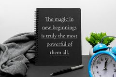 Inspirational new year concept and life quote on notepad. The Magic in New Beginnings is Truly the Most Powerful of Them All stock image