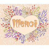 Inspirational phrase Merci framed by flowers Royalty Free Stock Photography